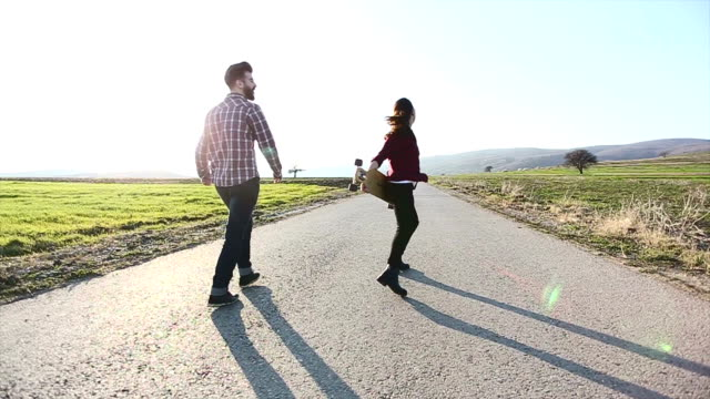 Cheerful skater couple on street video