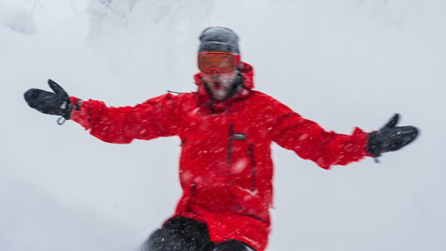cheerful snowboarder riding backcountry in snowy weather - snowboarding video stock e b–roll
