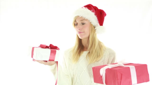 Cheerful woman holding christmas presents video