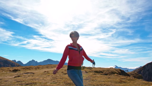 WS Cheerful Woman Skipping In The Mountains video
