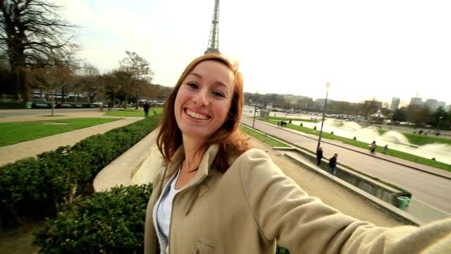 Cheerful woman takes selfie in Paris-Eiffel tower video