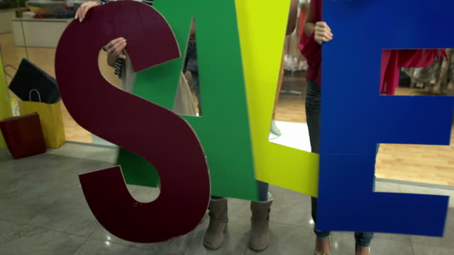 HD: Cheerful Women With Sale Sign video