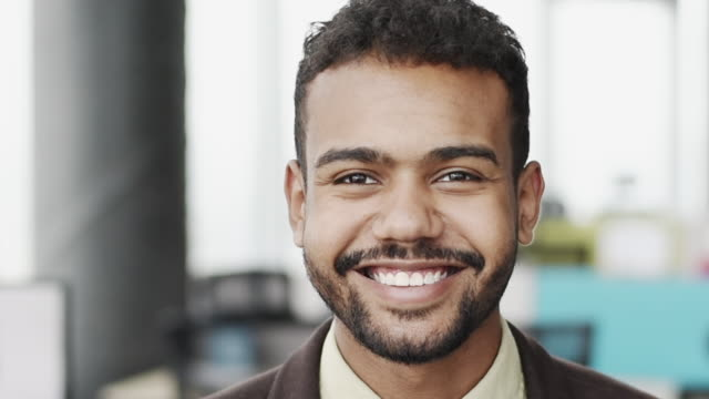 Cheerful young businessman close-up in office