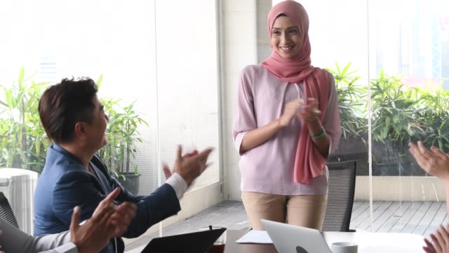 cheerful young malaysian woman being appluaded - malese video stock e b–roll