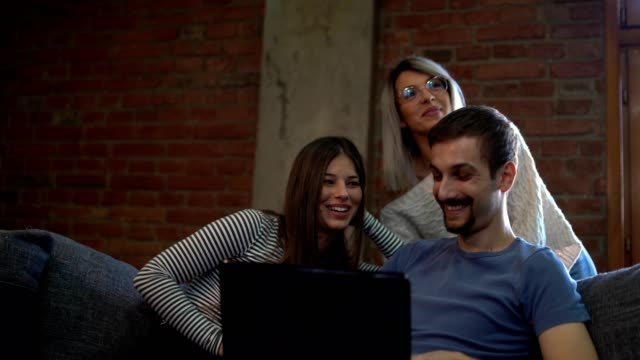 cheerful young people using a computer - miroslav mitic stock videos and b-roll footage