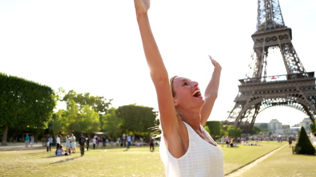 Cheering woman at Eiffel tower-Paris arms outstretched video