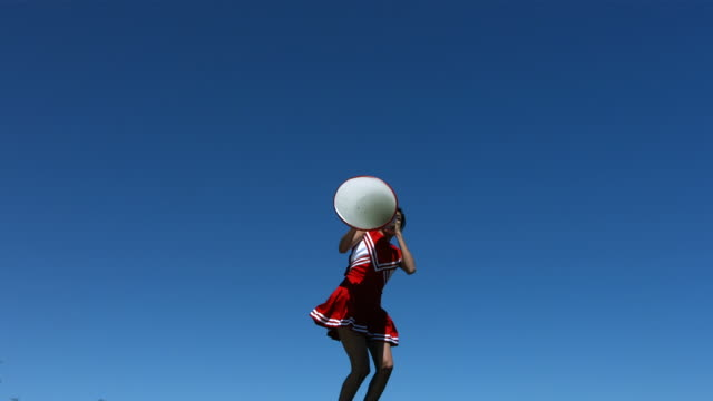Cheerleader with megaphone, slow motion  megaphone stock videos & royalty-free footage
