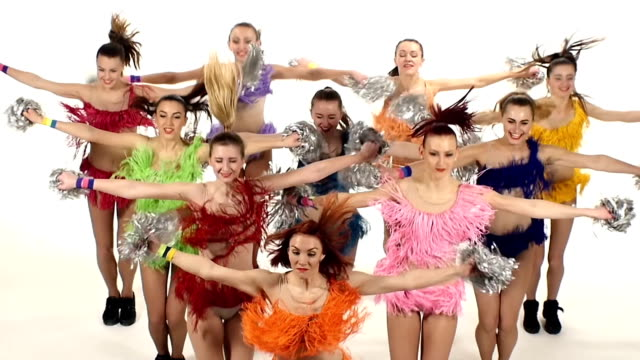 Cheerleading, girls dancing smiling at the camera. emotions. slow motion video