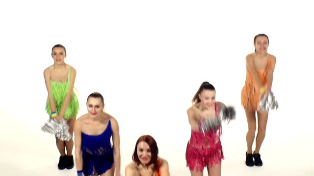 Cheerleading, girls dancing smiling at the camera, slow motion video