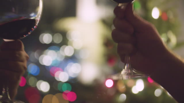 Cheers Red Wine Glasses Holiday Christmas Lights Close Up video