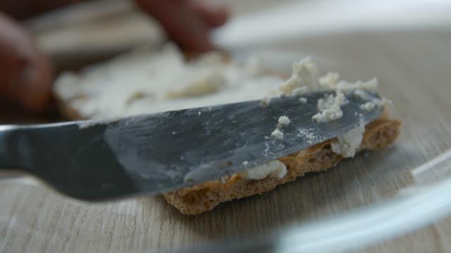 ost på wasa slowmotion - cheese sandwich bildbanksvideor och videomaterial från bakom kulisserna