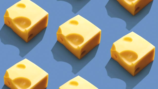 Cheese pattern on color background. Colorful cheese pattern of Cheese on color background. From top view cheese stock videos & royalty-free footage
