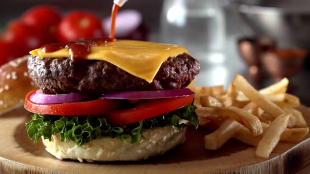 cheeseburger with bbq sauce - burgers stock videos and b-roll footage