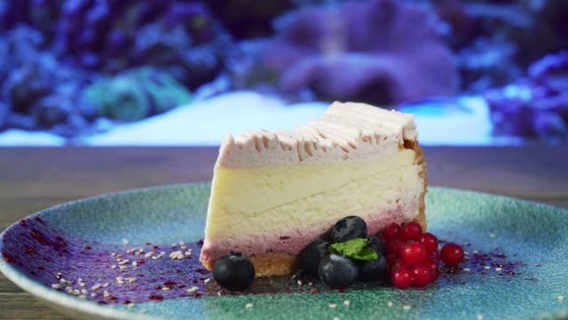 Cheesecake with berries on plate.