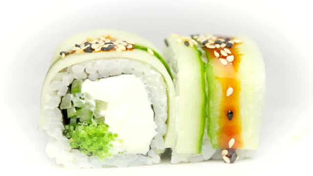 Chef adds soy sauce and sesame to Kappa Filla Maki with zucchini cheese and fresh salad sushi video