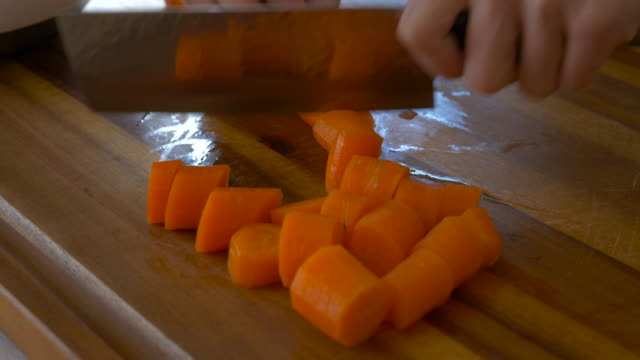 chef chopping carrot,close-up - gluten free stock videos and b-roll footage