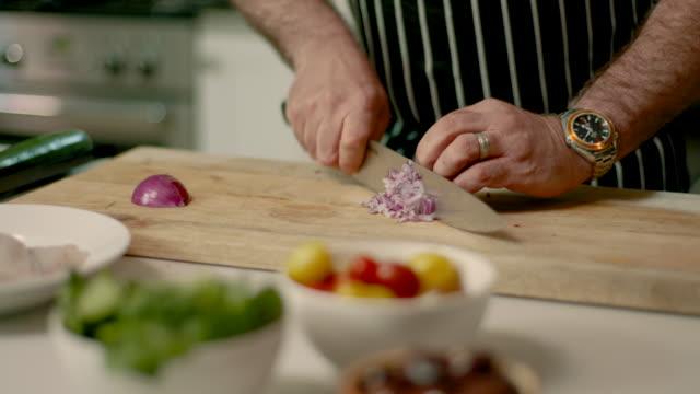 Chef chopping onion