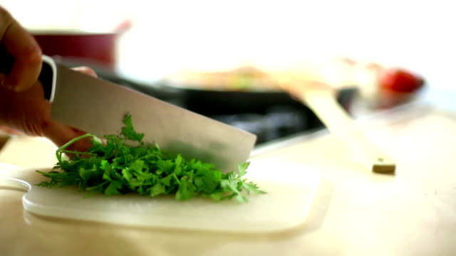 Chef chopping parsley on kitchen counter. video