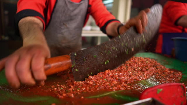 Chef chopping tomato and making salad in restaurant kitchen video
