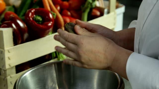 Chef cleans a artichoke video