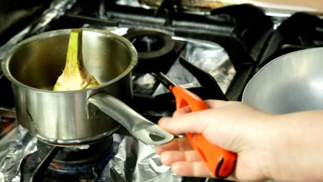 chef cook a artichoke in pot video
