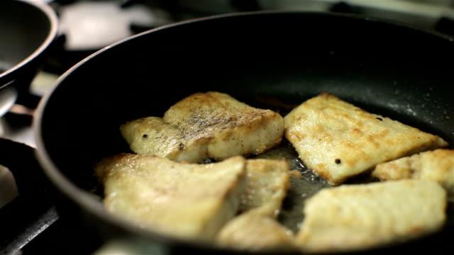 Chef cooking fish in flour in restaurant kitchen. Restaurant. Food. video