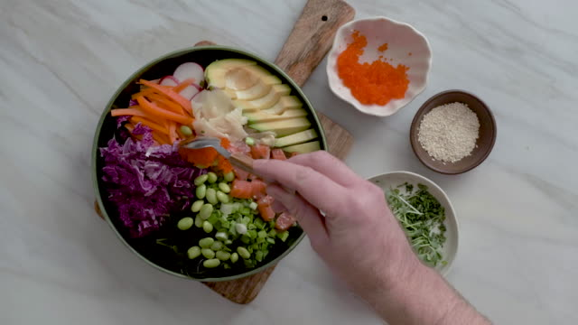 Chef cooking Poke bowl