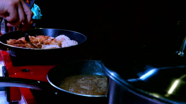 chef cooking seafood ball. Woman frying delicious crab and shrimp cake in a pan on gas stove. homemade cuisine, restaurant menus, healthy eating concept video