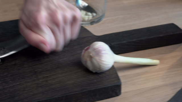 chef crushes garlic cloves video