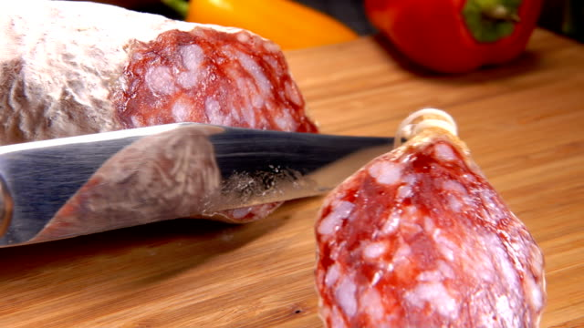 Chef cuts jerked sausage with knife video