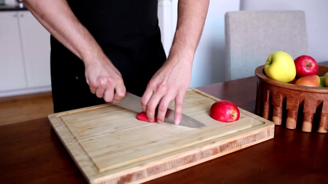 Chef cutting a red apple in small cubes video