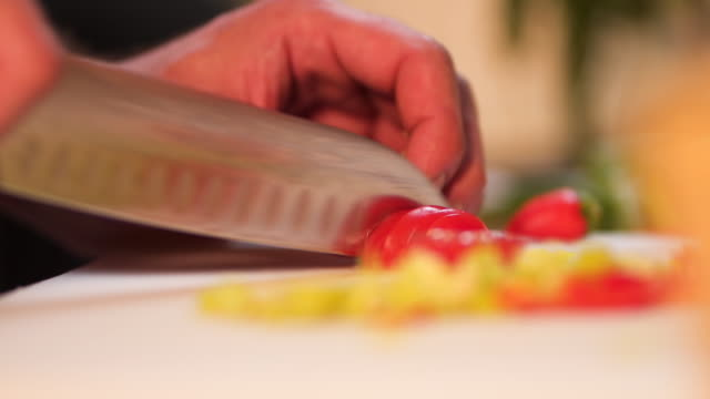 Chef cutting cherry tomato Chef cooking pasta and vegetables frying pan stock videos & royalty-free footage