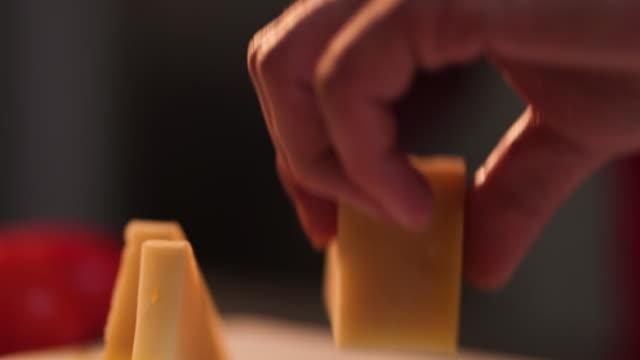 Chef cutting parmesan cheese