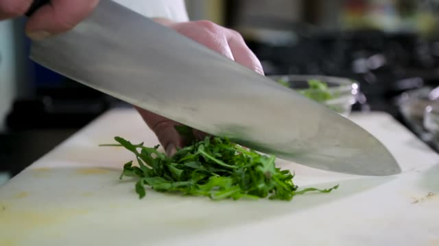 Chef cutting parsley Chef cutting parsley parsley stock videos & royalty-free footage