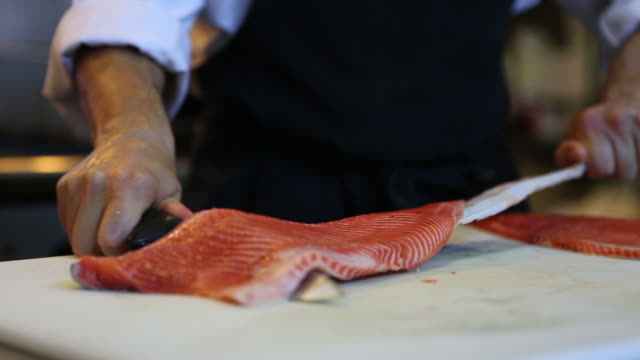 Chef cutting salmon seafood video