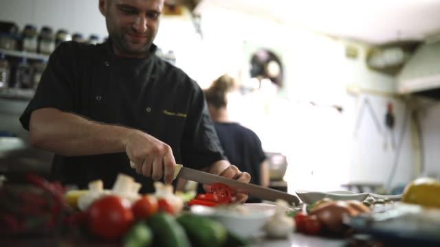 Chef Cutting Veggies At Restaurant