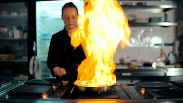 Chef doing flambe with sausage video