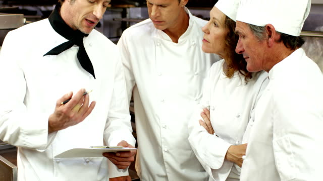 Chef explaining a document to his colleagues video