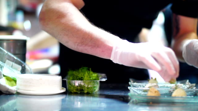 chef finishing a meal. - busy restaurant kitchen stock videos & royalty-free footage