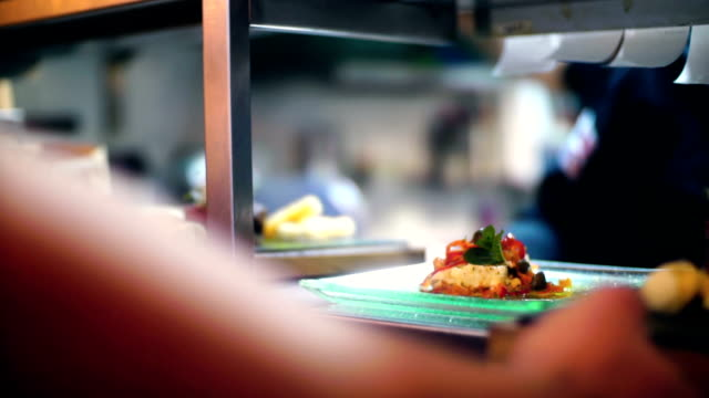 chef finishing meals at a fine dining restaurant. - busy restaurant kitchen stock videos & royalty-free footage