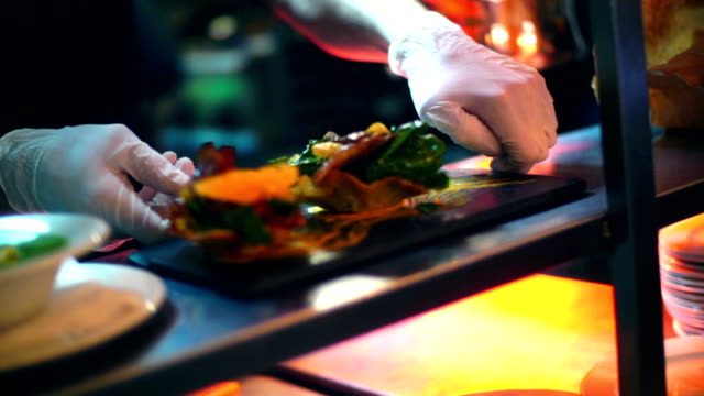 Chef finishing meals at a fine dining restaurant. video