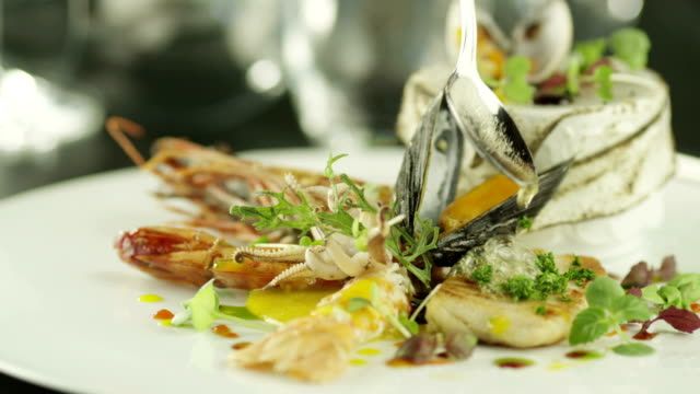 Chef Garnishing Delicious Selection of Seafood with Oil. video