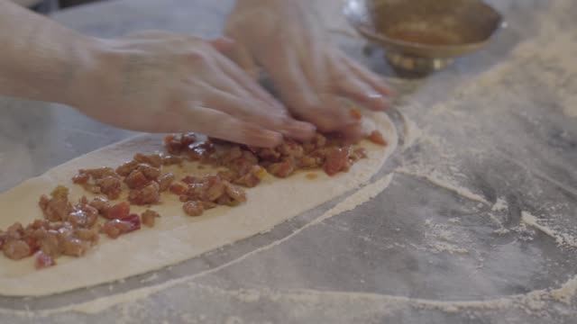 chef hands making turkish arab food fatayer in modern restaurant close up. - chleb pita filmów i materiałów b-roll