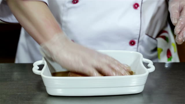 Chef is preparing a meat dish in the restaurant. video