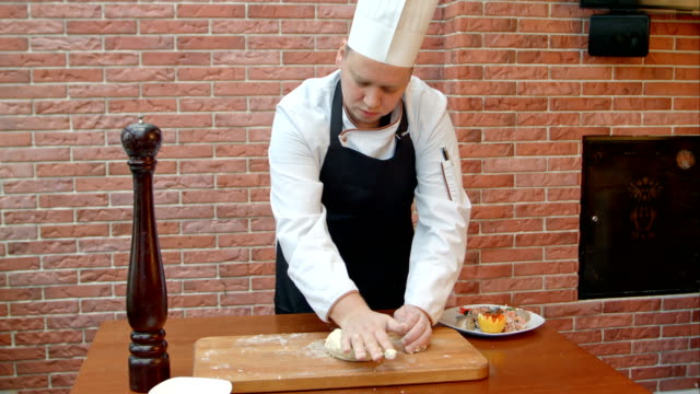 Chef kneading a dough video