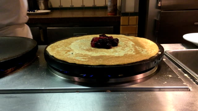 A chef makes a crepe. video