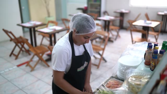 Chef organizing food for self service