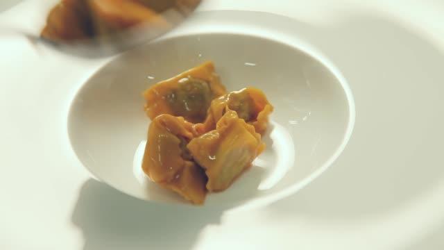 chef plating ravioli agnolotti with sauce chef plating ravioli agnolotti with sauce ravioli stock videos & royalty-free footage