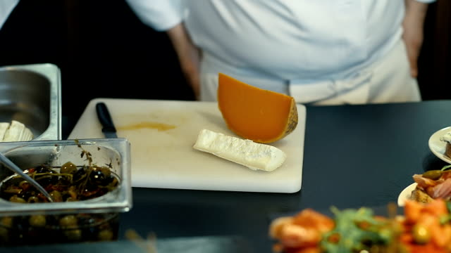 Chef Preparing Cheese on Board video