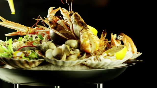 Chef Preparing Delicious Seafood Dish with Oysters and Prawns. video